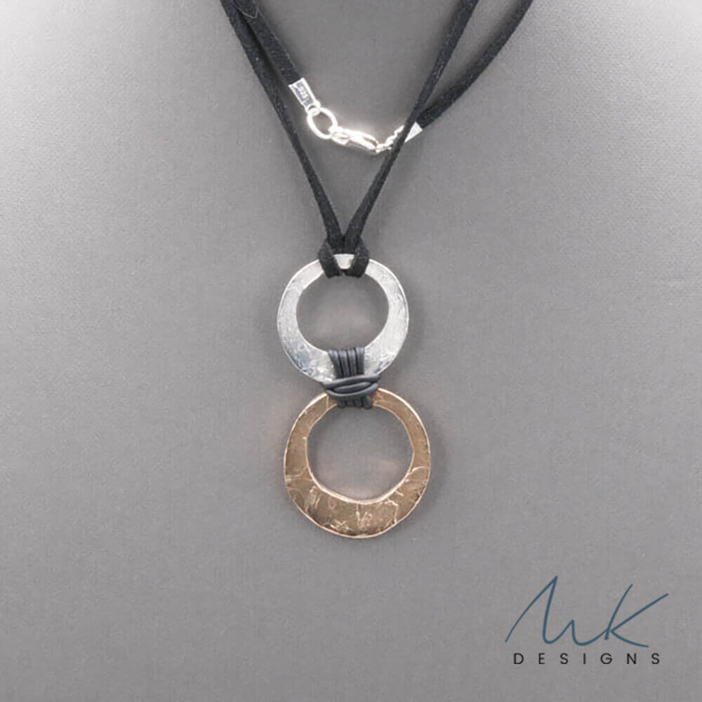 e85fa926df09e Double Hammered Bronze and Sterling Silver Circle Necklace